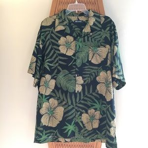 Aloha shirt with green leaves and hibiscus flowers